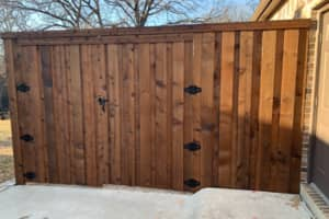 Front gate to a beautiful fence installed in Denton