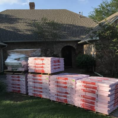 Roofing supplies ready to go up on a job site in Denton!